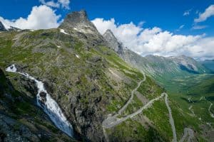 The Troll Road with its hairpin bends and the Stigfossen waterfall outside Åndalsnes, Norway