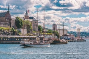 A view of the Akershus Fortress and boats from the water in Oslo, Norway