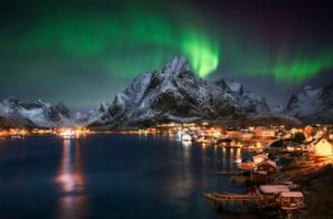 The Northern lights over a fishing village in Lofoten, Norway